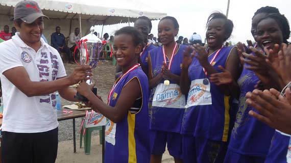 FootPrints girls being handed the trophy